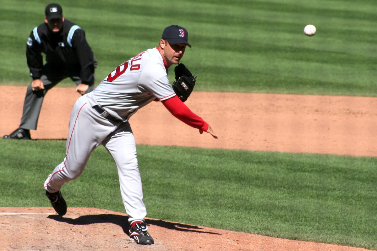 Tim Wakefield follows through on a knuckleball at Fenway Park